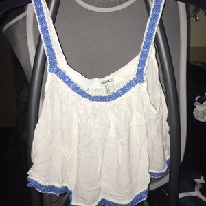 White crop top with blue trim